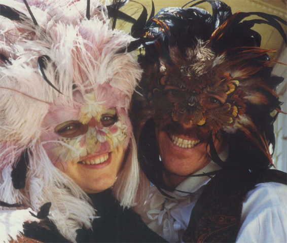 Danusia and Ron in feather masks, New Orleans about 1988